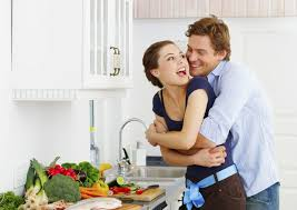 couple guy hugging girl in kitchen