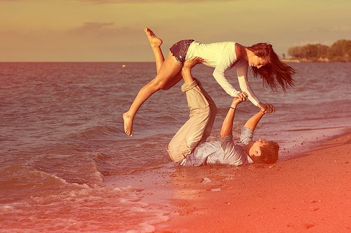 Couple playing at beach